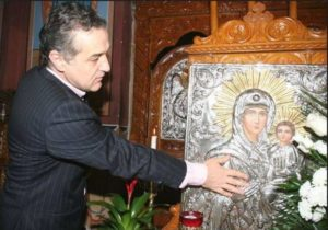 becali in biserica