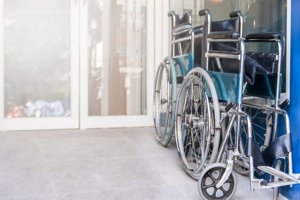 wheelchair are fold and park in the hospital entrance, Medical equipment for use as a means of transport by a person who is unable to walk as a result